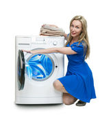 The happy young woman near the new washing machine — Stock Photo