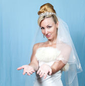 The happy bride on a blue background — Stock Photo