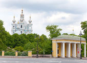 View on Smolnyi cathedral (Smolny Convent) St. Petersburg through the square of Proletarian dictatorship. — Stock Photo