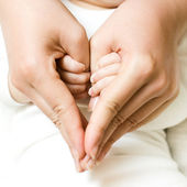 Baby holding mother hand — Stock Photo