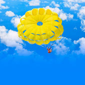 Female parachutist over blue summer sky — Stock Photo