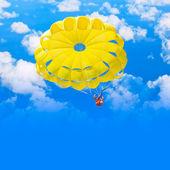 Female parachutist over blue summer sky — Stock Photo