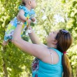 Happy mother and baby — Stock Photo #11467210