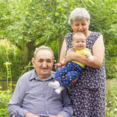 Elderly couple with granddaughter — Stock Photo