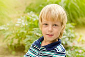 Smiling little boy in the park — Stock Photo