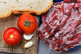 Iberian Ham with tomato bread and Garlic — Stock Photo