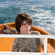 Stock Photo: Kid Driving a Pilot Boat