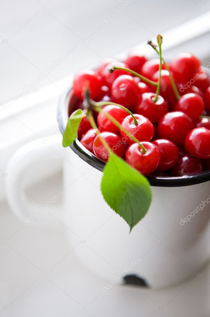 Red cherries in little white pot  Stock Photo #11467250