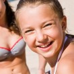 Pretty girl having fun on the beach — Stock Photo #12341760