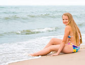 Blond girl on the beach — Stock Photo