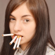Woman with cigarettes - Stockfoto