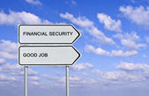 Road sign to good job and financial security — Stock fotografie