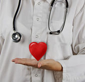 Doctor with gift of love — Stock Photo