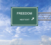Road sign to freedom — Stock Photo