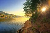 Sunny sunset over the lake — Stock Photo