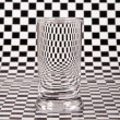 Small glass with distortion — Stock Photo