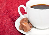 Closeup of coffee and chocolates — Stock Photo