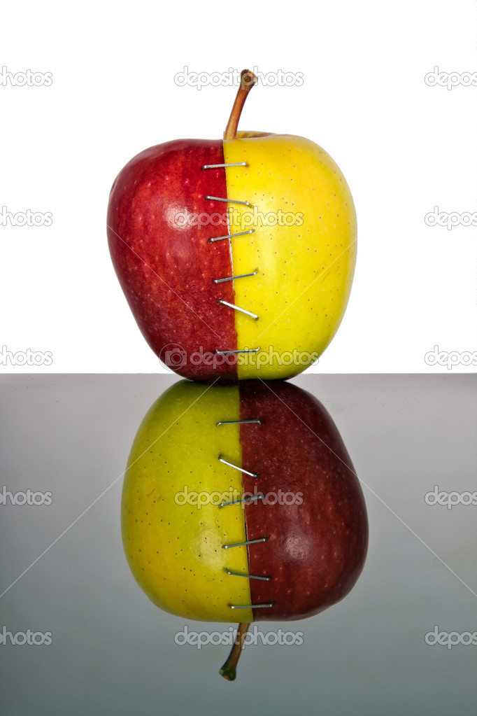 Red and yellow apple halves joined together with inverse reflection — Stock Photo #10860355