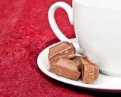 Macro of coffee cup and chocolate blocks — Stock Photo