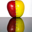 Royalty-Free Stock Photo: Yellow and red apple halves