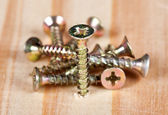 Screws on a wooden table — Stock Photo