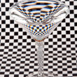 Martini glass on check paper — Stock Photo