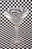 Martini glass on check paper — Stock Photo