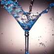 Liquid splash in a martini glass — Stock Photo