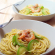 Spaghetti pasta with fresh shrimps and zucchini sauce — Stock Photo