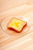 Bread butter and honey — Stock Photo