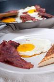 Eggs bacon and toast bread — Stock Photo