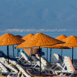 Beach loungers and umbrellas on the sea. - Photo
