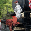 Marble sculpture on the old locomotive — Stock Photo