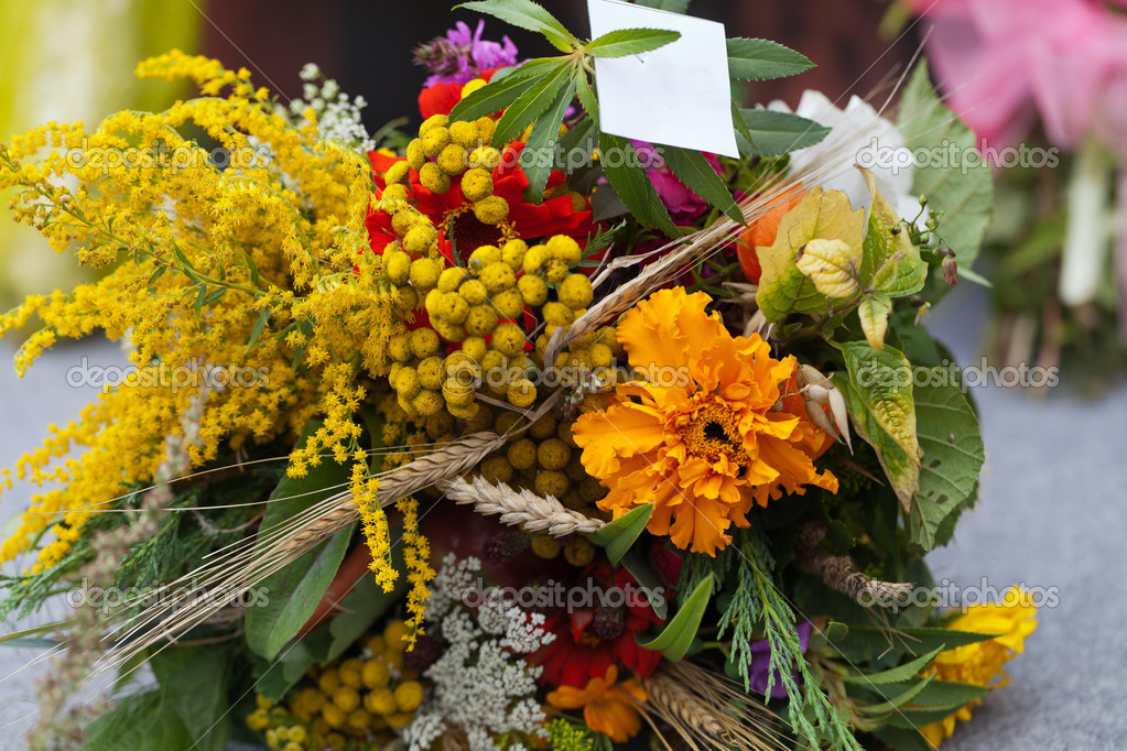 Beautiful bouquets of flowers and herbs — Stock Photo #12317585