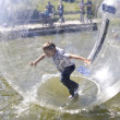 Stock Photo: Boy Swim inside pastic bubble