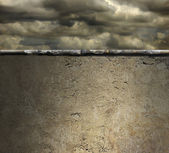 Stormy Sky Over a Concrete Wall Background — Stock Photo