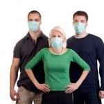 Young wearing flu masks — Stock Photo