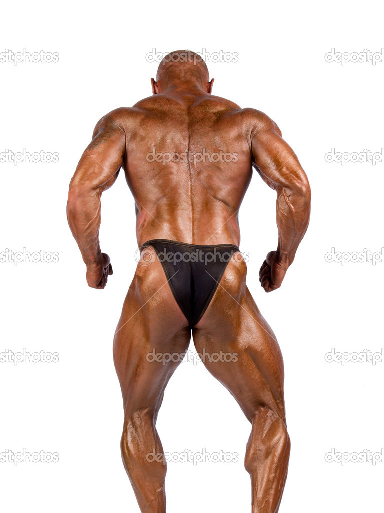 Bodybuilder flexing his muscles in studio — Stock Photo #11550654