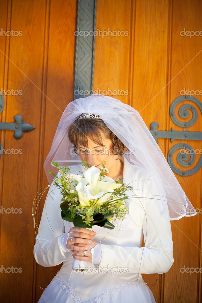 Young beautiful young bride over brick wall — Stock Photo #11874976