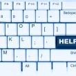 White computer keyboard with the blue button help — Stock Photo