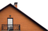Roof and balcony of house from red brick — Stock Photo