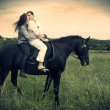 Couple and horse in a field — Stock Photo #11926553