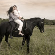 Couple and horse in a field — Stock Photo