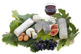 Goat cheeses and fruits — Stock Photo