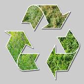 återvinna tecken med gräs — Stockfoto