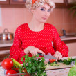 Woman in red cutting vegetables — Stock Photo #10871634