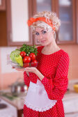 Woman with vegetables in kitchen — Stock Photo