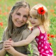 Mother and daughter in poppy field — Stock Photo #11011769
