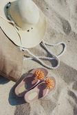 Beach items lying on sand — Stock Photo