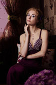 Retro-styled woman in violet dress — Стоковое фото